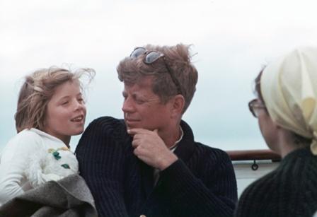 John F. Kennedy with Jacqueline Onasis Kennedy and Caroline Kennedy